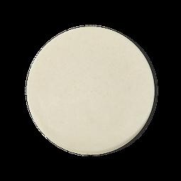 A perfectly circular face wipe in a neutral cream colour