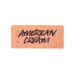 """A peach-coloured rectangular piece of soap paper, stamped with the words """"American Cream"""""""