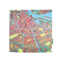 A map of Amsterdam city centre printed onto a silk scarf, showing buildings in red, squares of yellow and blue canals
