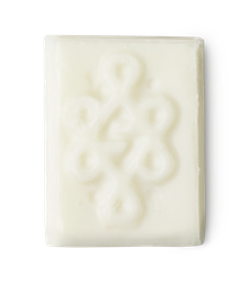A square of white solid deodorant, with a textured swirly pattern stamped into the top.
