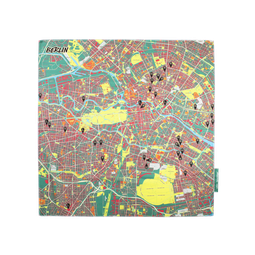 """A map of Berlin printed onto a textile square. Buildings are in red, parks in yellow and """"BERLIN"""" is written on top."""